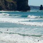 Praia Arrifana surfers waves